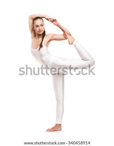 young beautiful woman yoga posing on isolated white studio background - stock photo