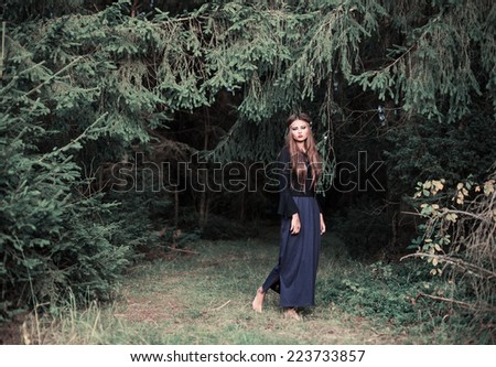 young beautiful women in  forest