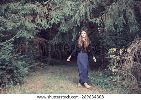 young beautiful women in forest - stock photo