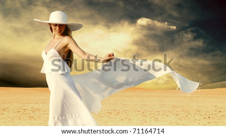 Young beautiful women in white, relaxation at sunny desert - stock photo