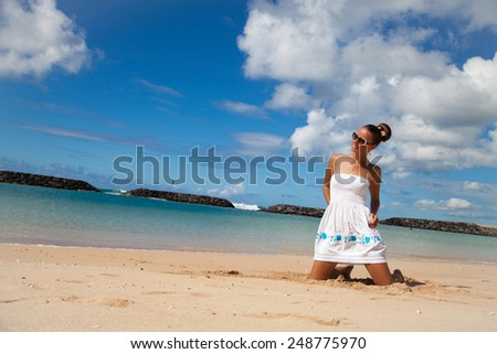 Young beautiful women on the sunny tropical beach, Hawaii. Magic Island peninsula in Honolulu. Vacations And Tourism Concept. - stock photo