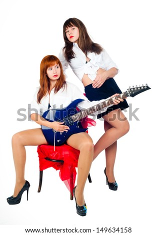 Young beautiful women with electric guitar at white background - stock photo