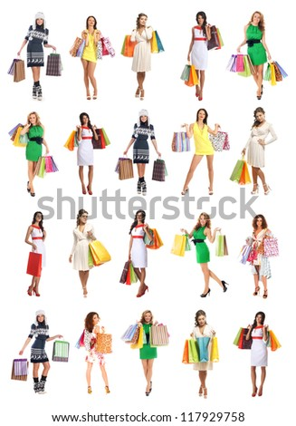 Young beautiful women with some shopping bags isolated on white - stock photo