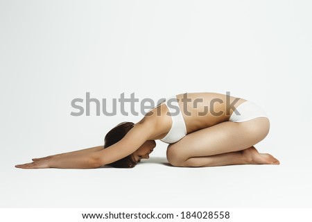 young beautiful yoga posing - stock photo