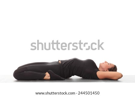 young beautiful yoga posing  . - stock photo
