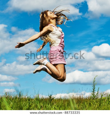 young beautiful young woman long hair high jumps - stock photo