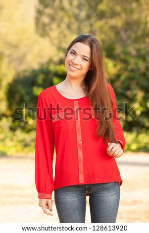 young beautiful young woman portrait on sunny day - stock photo