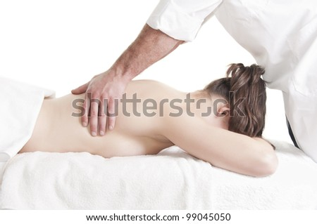Young beautiful young woman receiving back massage at spa - stock photo