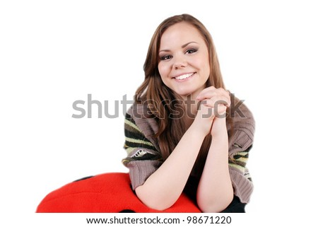 Young beautifully girl, teen girl, smiling, holding hands together, in sweater. - stock photo