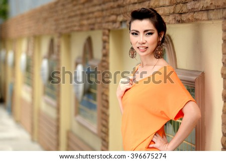 Young Beauty Asian Woman Smile posting in park, Thailand  - stock photo