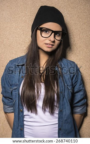 Young beauty brunette girl in glasses looking at camera.