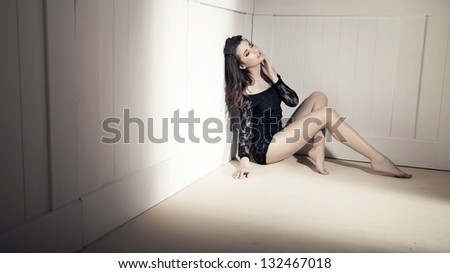 Young beauty brunette over white wall - stock photo