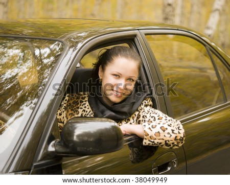 young beauty businesswoman sitting in her car