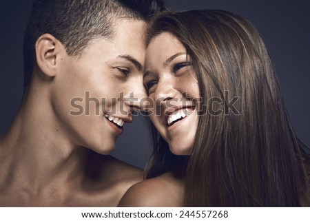 Young beauty couple sharing tender moments - stock photo