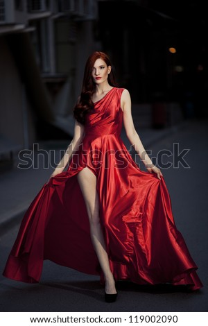 Young Beauty Famous Woman In Red Dress Outdoor