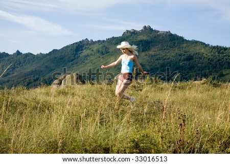 young beauty girl running on the summer road