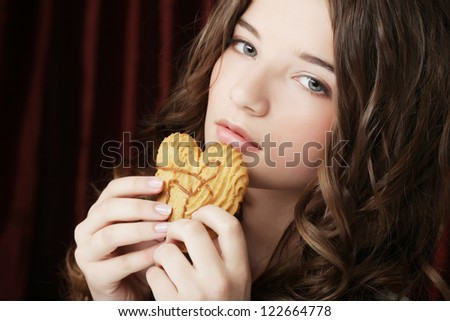 young beauty girl with cookie