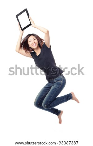 Young beauty happy jump and showing tablet pc in the air isolated on white background, model is a cute asian - stock photo