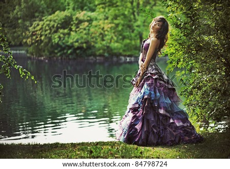 Young beauty in nature scenery - stock photo