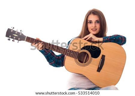 young beauty lady with guitar in hands smiling on camera isolated on white background