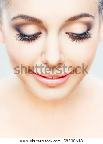 young beauty posing with eyes closed, studio shot - stock photo