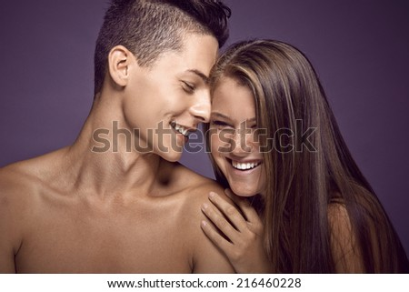 Young beauty teen couple sharing tender moments - stock photo