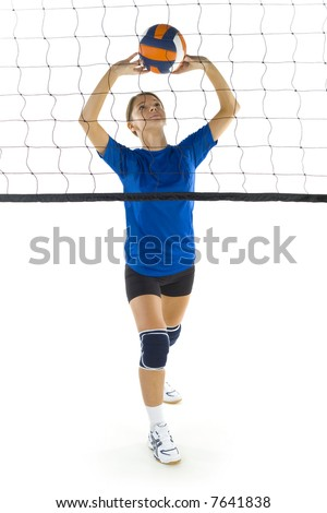 Young, beauty volleyball player. Standing in front of net with ball. White background. Whole body, front view