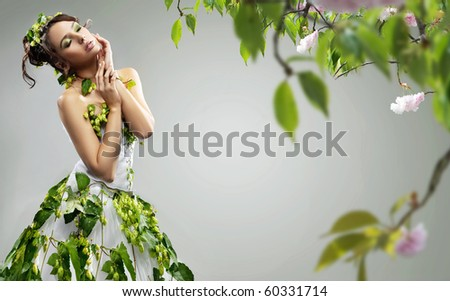 Young beauty wearing ecologic dress - stock photo