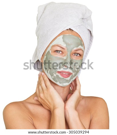 young beauty woman getting facial mask