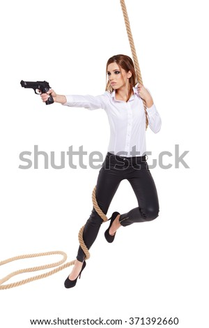 young beauty woman holding handgun - stock photo