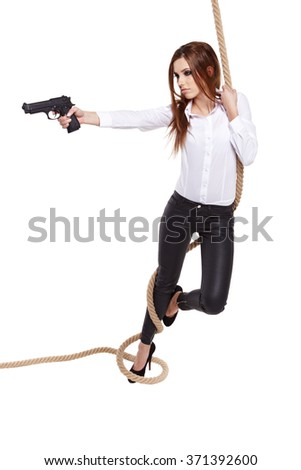 young beauty woman holding  handgun, ready to fight  - stock photo