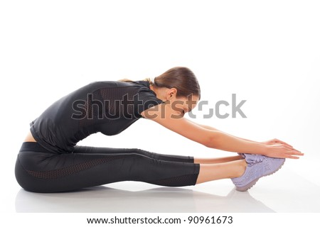 young beauty woman in gymnastic pose - stock photo