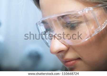 young beauty woman in modern research laboratory - stock photo