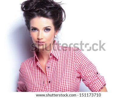 young beauty woman in red shirt and nice hairstyle looking at the camera - stock photo