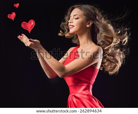 Young beauty woman in red waving flying  dress. Dancer in silk dress. Valentine's Day - stock photo