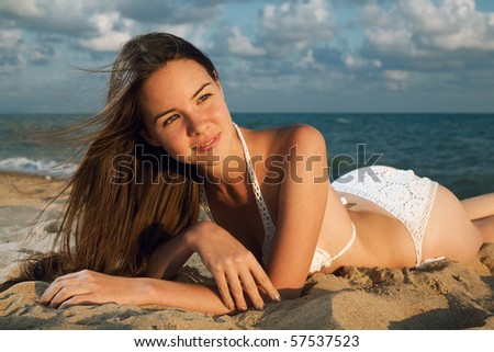 young beauty woman on sea under sky