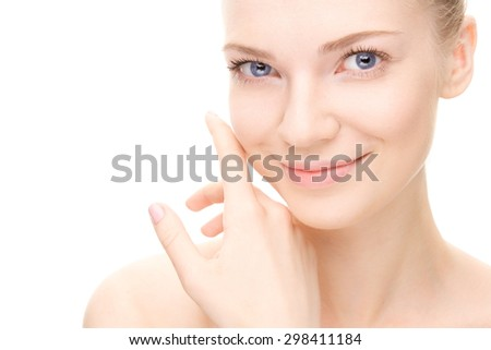Young beauty woman portrait.  Girl Touching her Face. Studio shot. Isolate on white. Health Care, cosmetic concept. Blank for commercial advertising - stock photo