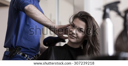Young beauty woman relaxing in hairdresser's salon - stock photo