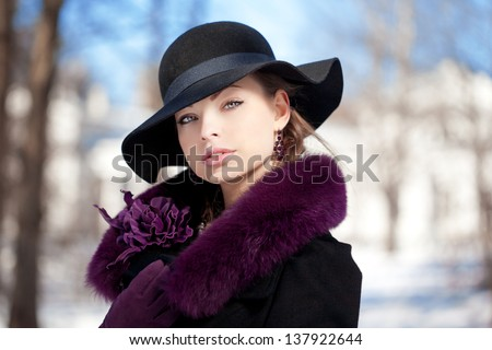 Young beauty woman winter portrait. - stock photo