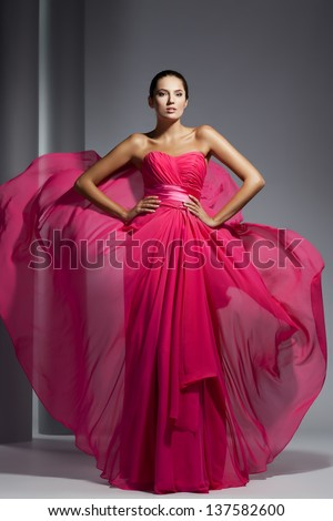 Young beautyful adult girl wearing elegant evening dress - stock photo