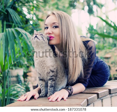 young beautyful woman playing with cat - stock photo