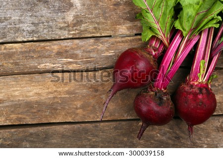 Young beets on wooden table - stock photo