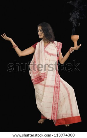 Young Bengali woman performing ritual dance - stock photo