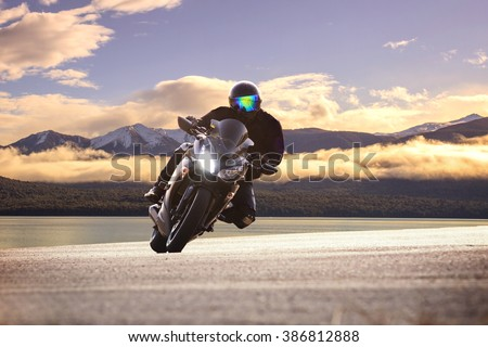 young bike man riding  motorcycle in traveling trip - stock photo