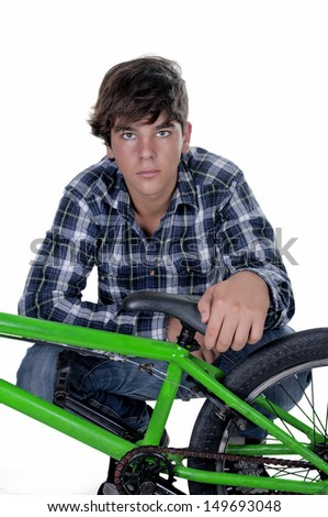 Young,  biker with BMX and looking at camera. Isolated on white background.  - stock photo