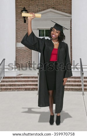 Young black african American woman in her graduation robes - stock photo
