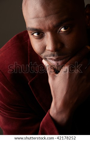 Young black African businessman in semi-formal clothes on a grey background with various facial expressions. Not Isolated, Part of a series.