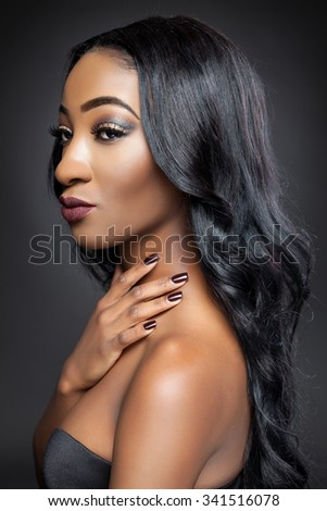 Young black beauty with elegant long curly hair