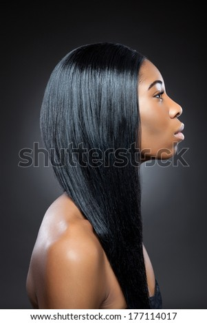 Young black beauty with long straight hair