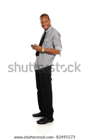 Young Black Businessman smiling and holding a smart phone isolated on a white background